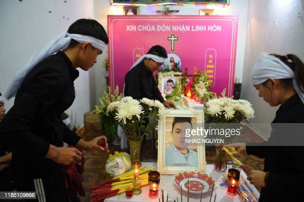 Family members of Hoang Van Tiep prepare his coffin bearing his remains for a funeral church service in Dien Chau district Nghe An province on...