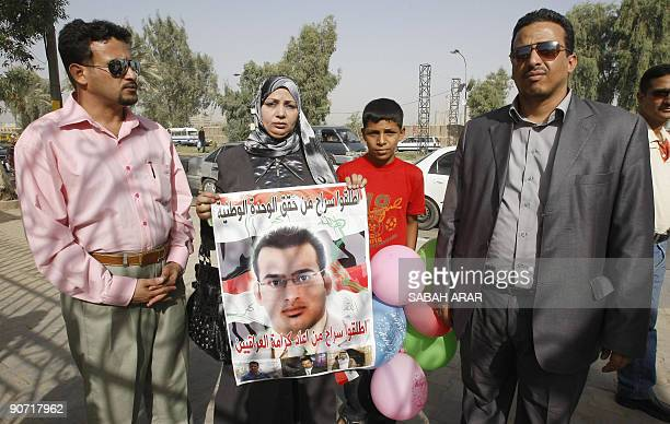 Family members of jailed Iraqi journalist Muntazer alZaidi from left to right brother Durgham sister Dunia nephew and brother Udai wait outside...