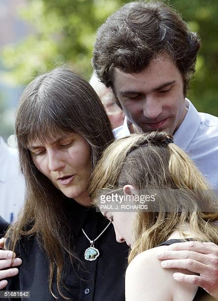 Family members of John Walker Lindh mother Marilyn Walker brother Connell Lindh and sister Naomi Lindh comfort each other 15 July 2002 outside the...