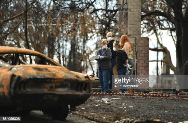 Family members of Karen Aycock who died during the fire sift through the remains of her burned home in the Coffey Park area of Santa Rosa California...