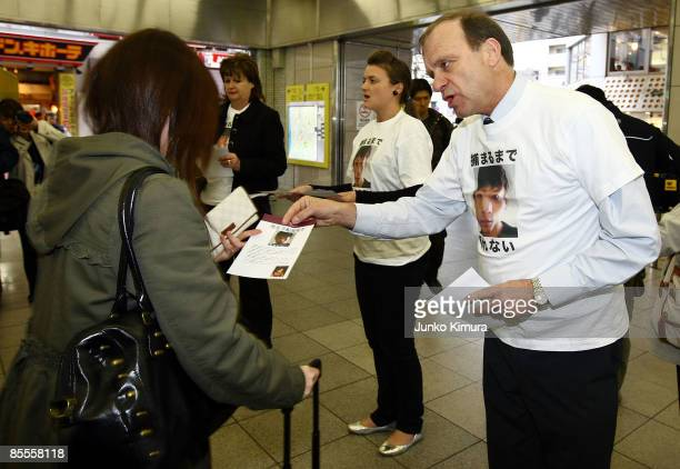 Family members of Lindsay Ann Hawker, Bill Hawker , Louise Hawker and Julia Hawker distribute flyers to commuters appealing for information on...