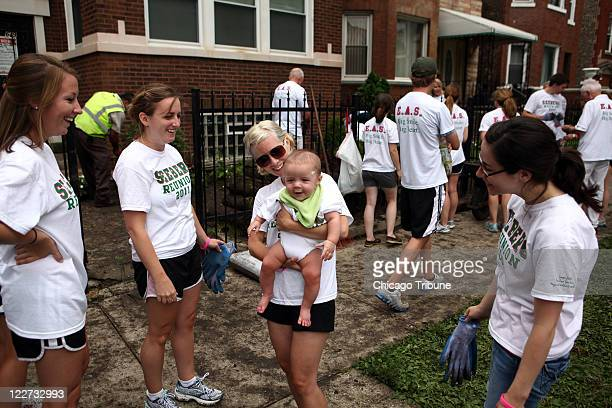Family members of Lizzy Seeberg came out to the Austin neighborhood of Chicago Illinois on August 6 to help landscape a volunteer house in honor of...