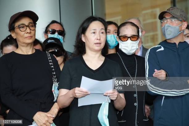 Family members of Macao casino tycoon Stanley Ho Hungsun speak to media outside Hong Kong Sanatorium and Hospital where Stanley Ho died on May 26...