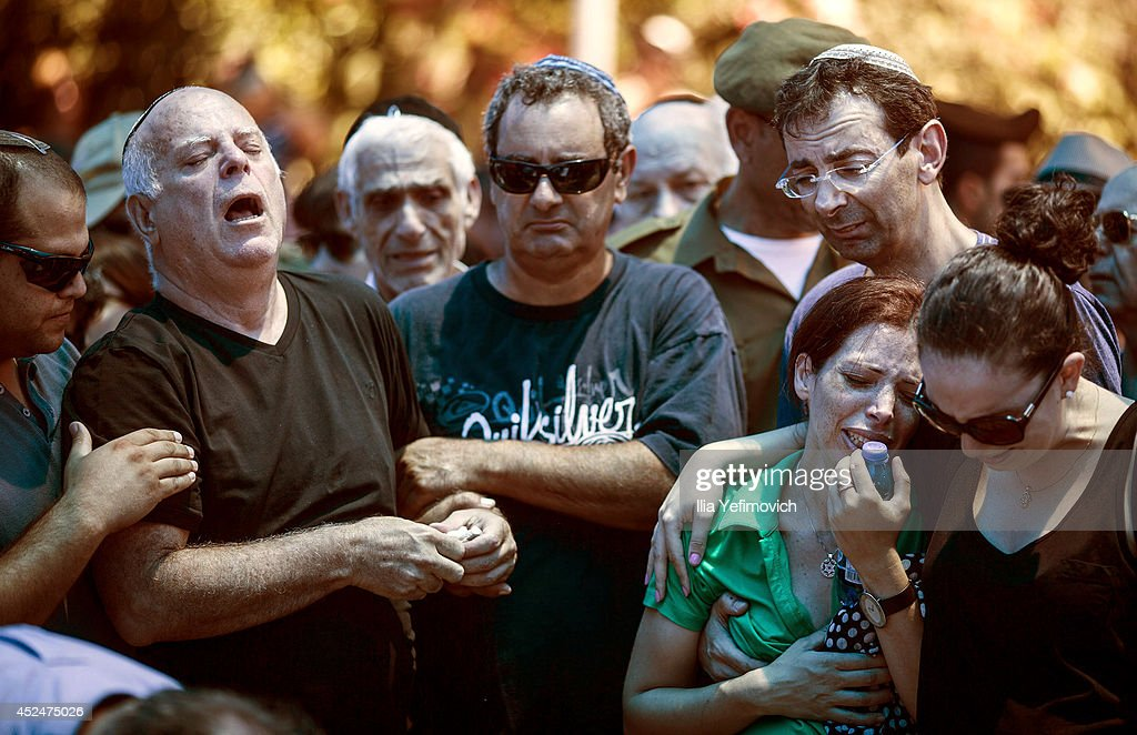 Family members of Major Tsafrir Bar-Or mourn and cry during his funeral on July 21, 2014 in Holon, Israel. Major Tsafrir was killed during the operation 'Protective Edge, raising the number of dead on Israeli side since the beginning of the ground envision to 18. According to Palestinian sources more then 400 killed in Gaza since the begging of the operation.