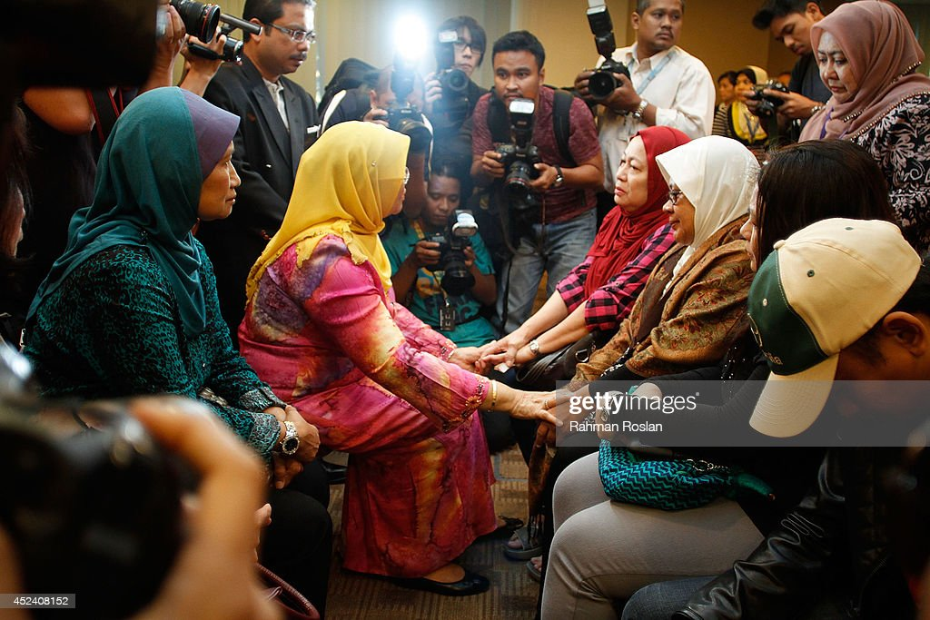 Family members of MH17 victim being comforted by Malaysian Minister of of Women, Family and Community Development, Rohani Abdul Karim on July 20, 2014 in Kuala Lumpur, Malaysia. Malaysia Airlines flight MH17 was travelling from Amsterdam to Kuala Lumpur when it crashed killing all 298 on board including 80 children. The aircraft was allegedly shot down by a missile and investigations continue over the perpetrators of the attack.