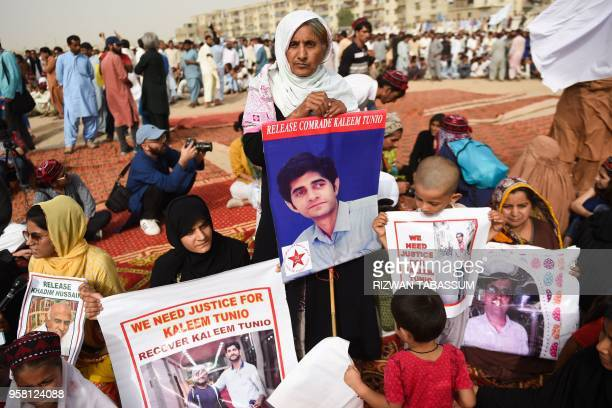 Family members of missing Pakistanis people hold their relatives pictures at a protest rally of Pashtun Tahafuz Movement in Karachi on May 13 2018...