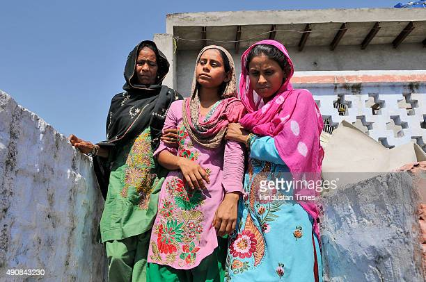 Family members of Mohammad Akhlaq are in shock while politicians visited and consoled them at Bisada villageon October 1 2015 in Greater Noida India...