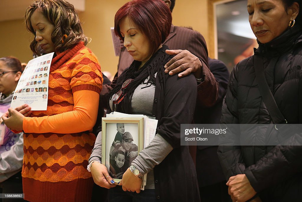 Family members of murder victims hold a press conference on December 31, 2012 in Chicago, Illinois. Chicago has had 504 murders in 2012.