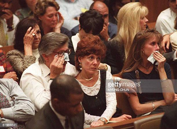 Family members of murder victims Nicole Brown Simpson and Ron Goldman cry in court as prosecutor Marcia Clark describes their murders in the OJ...