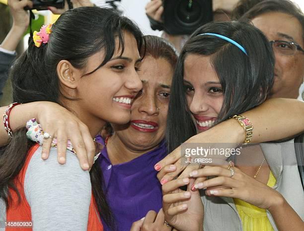 Family members of Nepalese man Govinda Prasad Mainali his wife Radma Mainali daughter Mithila Mainali and Alisha Mainali smile with their supporters...