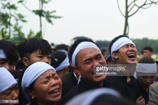 A family members of Nguyen Van Hung cry during burial of his remains at a cemetery Dien Chau distritct Nghe An province on November 28 2019 The...