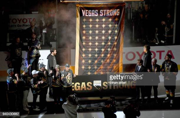 Family members of October 1 shooting victim Neysa Tonks line up at left and Vegas Golden Knights general manager George McPhee, Chairman, CEO and...
