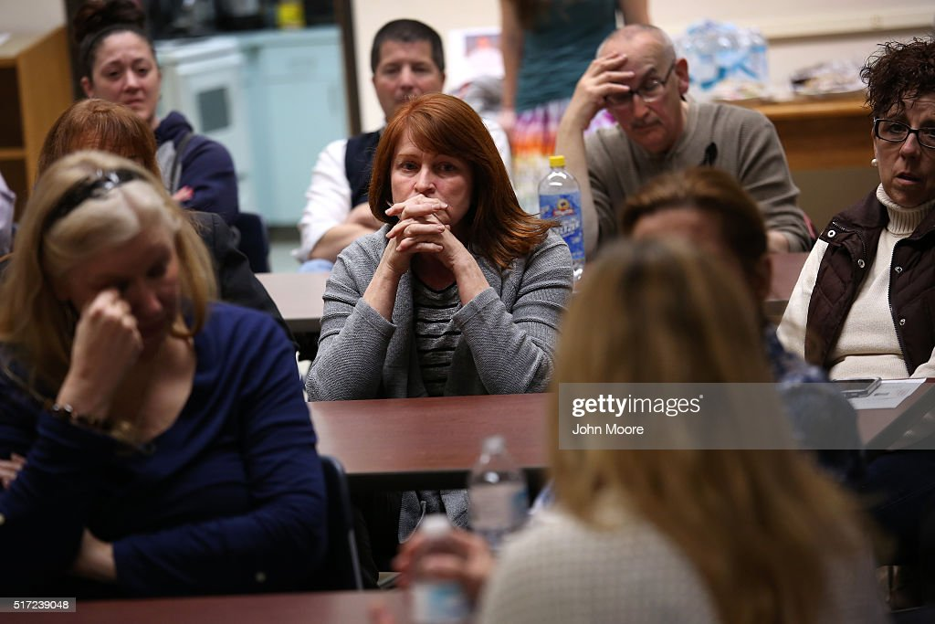 Family members of people addicted heroin and opioid pain pills share stories during a support group on March 23, 2016 in Groton, CT. The group Communities Speak Out organizes monthly meetings at a public library for family members to talk about how their loved ones' addiction affects them and to give each other emotional support. Communities nationwide are struggling with the unprecidented heroin and opioid pain pill epidemic. On March 15, the U.S. Centers for Disease Control (CDC), announced guidelines for doctors to reduce the amount of opioid painkillers prescribed nationwide, in an effort to curb the epidemic. The CDC estimates that most new heroin addicts first became hooked on prescription pain medication before graduating to heroin, which is stronger and cheaper.
