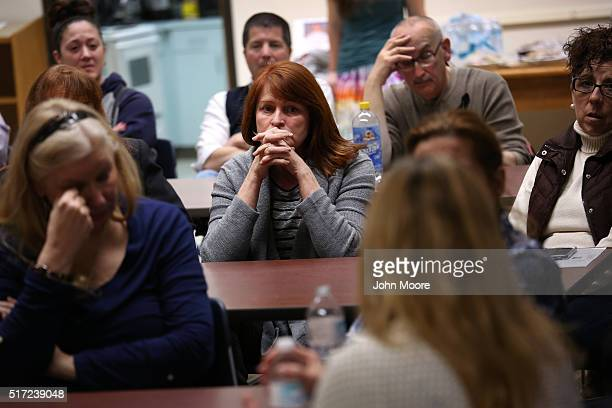 Family members of people addicted heroin and opioid pain pills share stories during a support group on March 23 2016 in Groton CT The group...