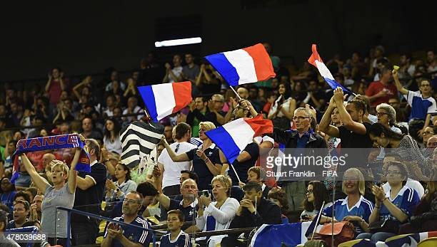 Family members of players of France show their support during the FIFA Womens's World Cup round of 16 match between France and Korea at Olympic...
