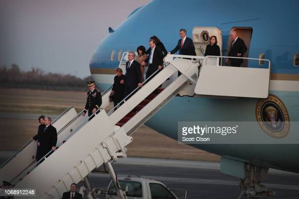 Family members of President George HW Bush arrive at Ellington Field on a flight from Washington D C with his remains on December 5 2018 in Houston...