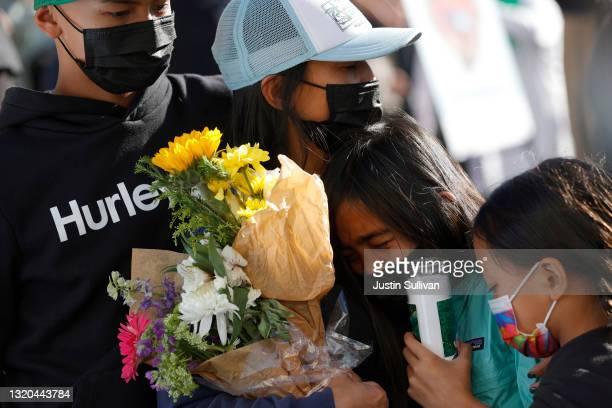 Family members of Santa Clara Valley Transportation Authority light rail yard shooting victim Paul Megia react during a vigil at San Jose City Hall...