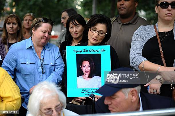 Family members of September 11 terrorist attacks victims wait for Pope Francis to arrive at the 9/11 memorial in New York on September 25 2015 Pope...