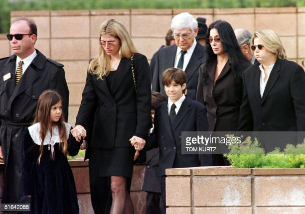 Family members of Sonny Bono walk to the grave site during the burial ceremony for the entertainer and US Congressman at the Desert Memorial Cemetery...