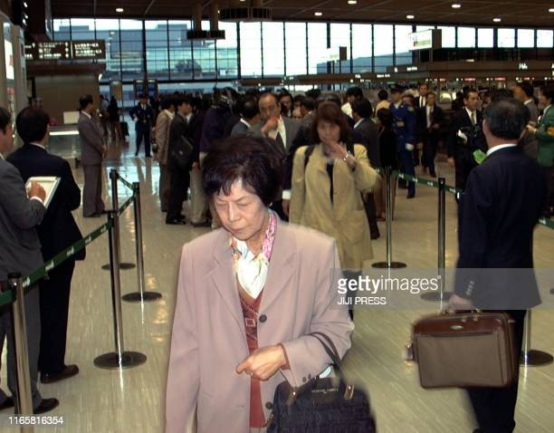 Family members of the 10 Japanese who were killed in 17 November's terrorist attack in Luxor south of Cairo leave Japan's Narita Airport on 19...