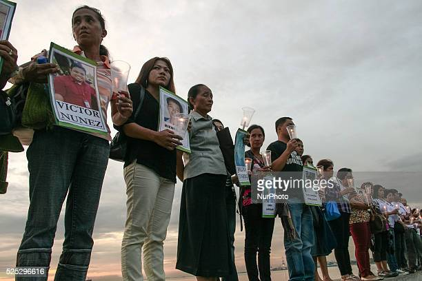 Family members of the 34 journalist that were killed in Maguindanao four years ago hold candles in remembrance of their departed loved ones Members...