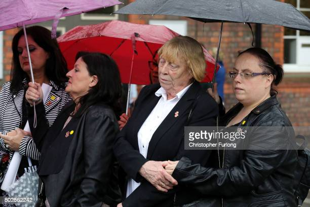 Family members of the 96 Hillsborough victims react as they address the media after they were told the decision that the Crown Prosecution Service...