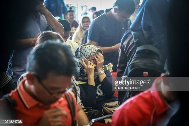 Family members of the crashed Indonesian Lion Air JT610 react at Pangkal Pinang airport in Bangka Belitung province on October 29 2018 An Indonesian...
