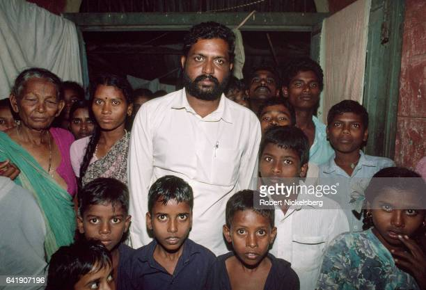 Family members of the Dalit caste or Untouchables gather for a photograph October 28 1991 in rural Andhra Pradesh India A number of families...
