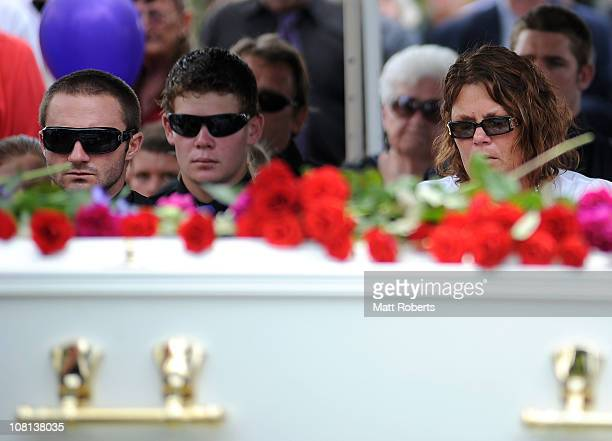 Family members of the deceased mourn at the funeral of mother and son killed in last week's flash floods on January 19 2011 in Toowoomba Australia...