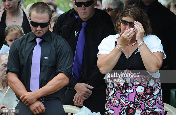 Family members of the deseased mourn at the funeral of mother and son killed in last week's flash floods on January 19 2011 in Toowoomba Australia...