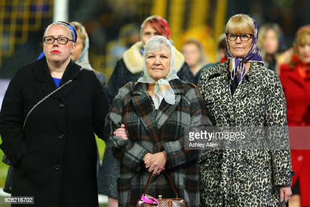 Family members of the Hull triple trawler tragedy are honoured with a applause from the crowd during the Sky Bet Championship match between Hull City...