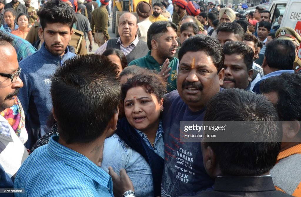 Family members of the injured near the spot where the Police Force NDRF and Army personnel carrying out rescue operations after a five storied...