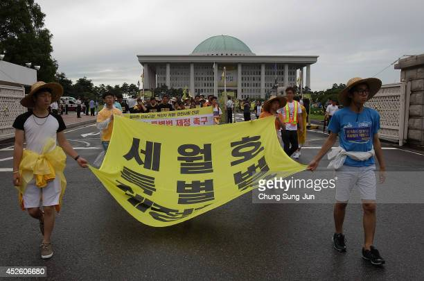 Family members of the Sewol ferry victims march from the national assembly to central Seoul on July 24 2014 in Seoul South Korea As many as 180...