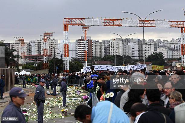 Family members of the Tam Airlines Airbus 320 victims of past July 17th leave flowers in the site of the accident after a march of over 5000 people...