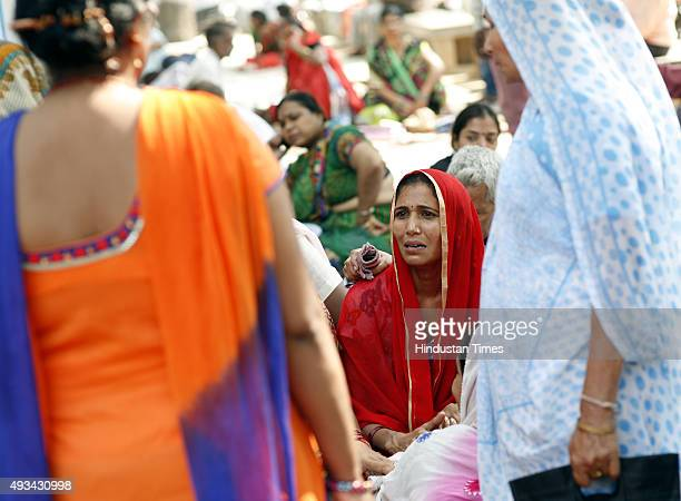 Family members of the two children of a Dalit family who were burnt alive while their parents got injured, at Burns Department, Safdarjung Hospital...