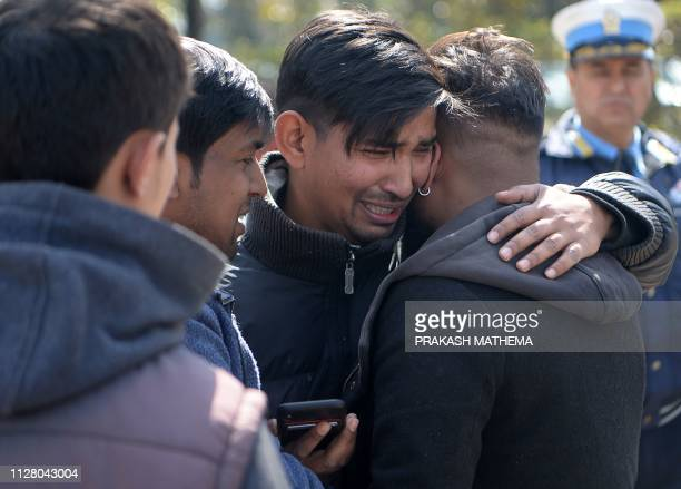 Family members of the victims of a helicopter crash react at Tribhuvan domestic Airport in Kathmandu on February 28 2019 Nepal's tourism minister...