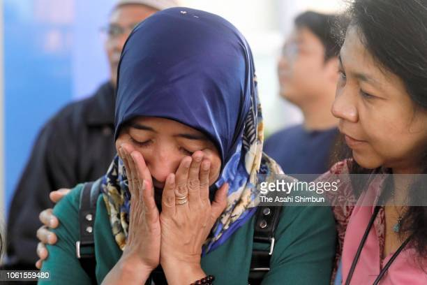 Family members of the victims shed tears after Lion Air flight JT 610 crash at the Police Hospital on October 30 2018 in Jakarta Indonesia Rescuers...