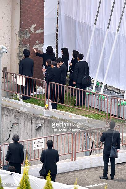 Family members of the victims touch a wall of an former apartment building which the derailed train crashed on the eleventh anniversary of the...