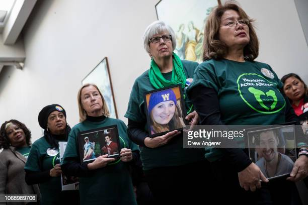 Family members of those killed by gun violence attend a news conference to demand action for gun violence prevention December 6 2018 in Washington DC...