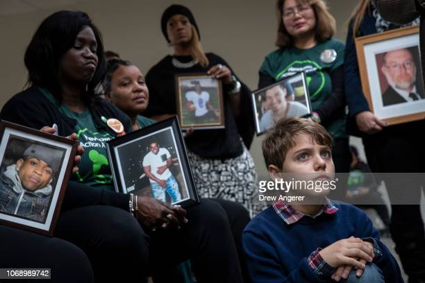 Family members of those killed by gun violence including 10 year old Dominic Gregorie who lost his aunt to gun violence attends a news conference to...