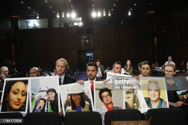 Family members of those who died aboard Ethiopian Airlines Flight 302 sit with pictures of their loved ones during a US Senate Commerce Committee...