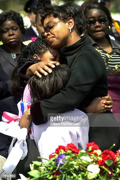 Family members of US Army Staff Sgt Terry Hemingway comfort each other during his burial at Beverly National Cemetery April 21 2003 in Beverly New...