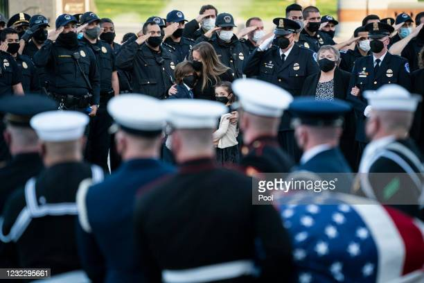 Family members of U.S. Capitol Police Officer William Evans, including wife Shannon Terranova, their 9-year-old son Logan and 7-year-old daughter...