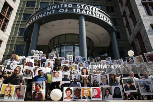Family members of victims from the Ethiopian Airlines Flight 302 crash hold photographs during a vigil outside the Department of Transportation in...