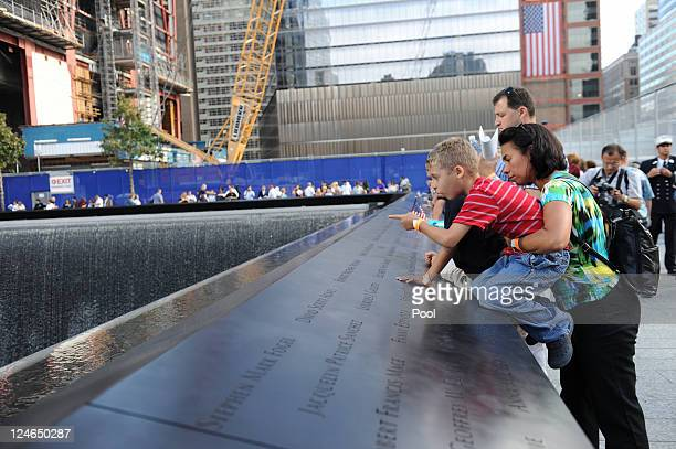 Family members of victims gather at the North Pool of the 9/11 Memorial during the tenth anniversary ceremonies of the September 11 2001 terrorist...