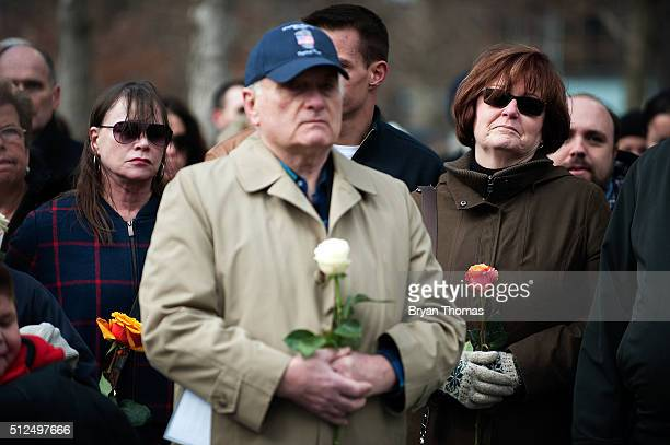 Family members of victims of the 1993 World Trade Center bombing hold roses at the 9/11 Memorial on February 26 2016 in New York City On the the 23rd...