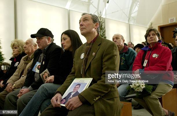 Family members of victims of the attack on the World Trade Center attend the dedication of a redesigned Memorial Park an enclave behind the Medical...