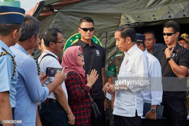 Family members of victims of the Lion Air flight JT 610 crash speak with Indonesian President Joko Widodo who had stopped by to get a briefing on...