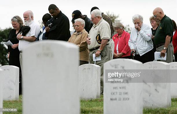 Family members of victims of the USS Cole attack bow their heads as they attend a ceremony to mark the fifth anniversary of the attack of USS Cole...