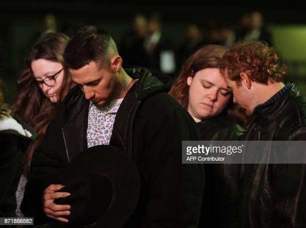TOPSHOT Family members of victims pray during a Prayer Vigil Honoring Victims of the First Baptist Church Shooting at the Floresville High School in...